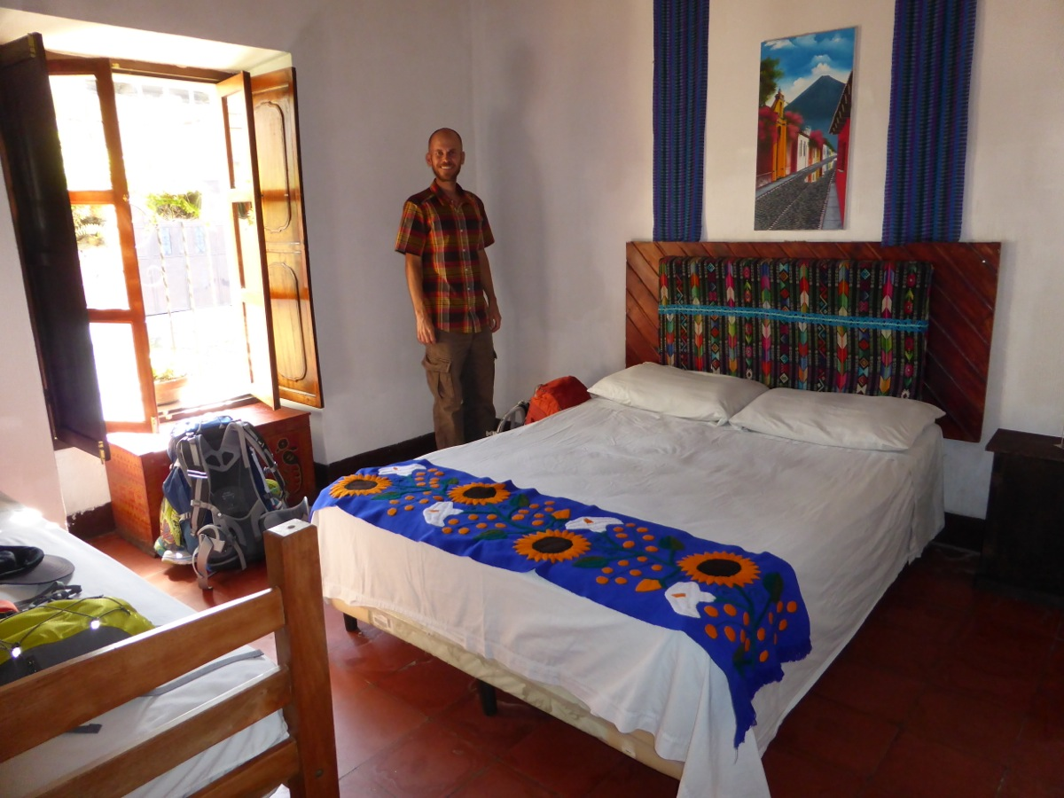 Our private bedroom at Hostal Holistico with beautiful, colourful fabrics and window seat