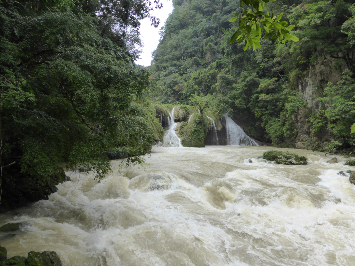 Rio Cahabon flowing under Semuc Champey's limestone bridge