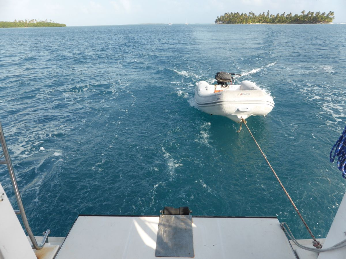 The dinghy behind the boat  during a short motor
