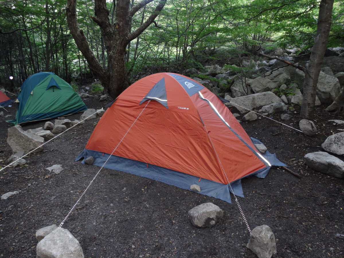 Our little orange tent bracing for a windy night at Campamento Torres