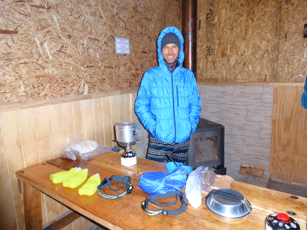 Making dinner while trying to stay warm in the Los Cuernos shelter