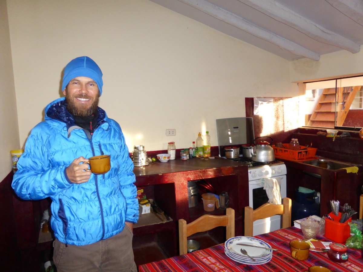 Warming up with coca tea in our hostel kitchen