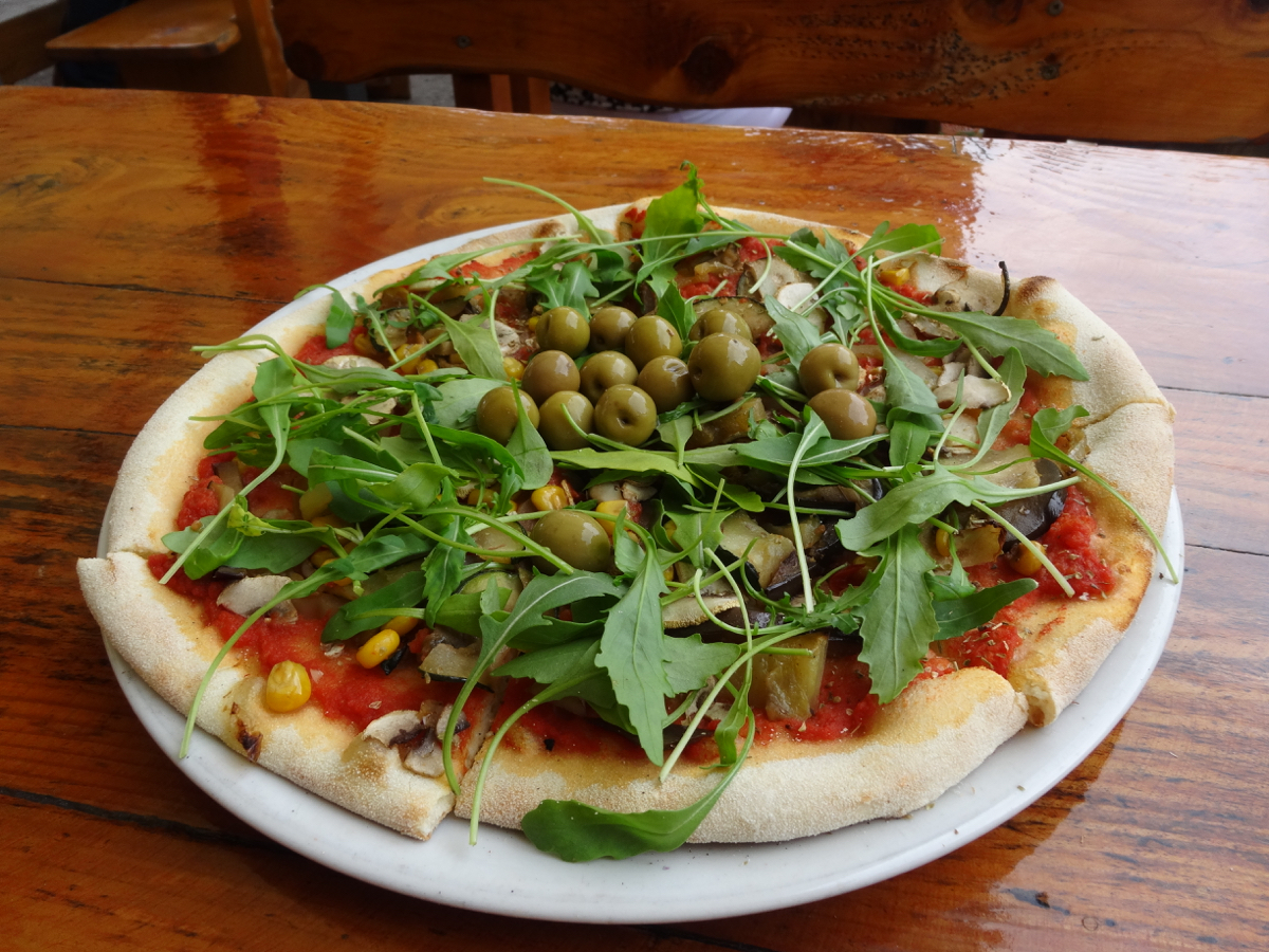 Gorgeous, colourful vegan pizza enjoyed on the patio overlooking the main square in Labin