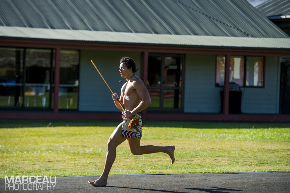 Maori warrior runs to greet/challenge representative of runners' tribe (photo credit: Marceau Photography)