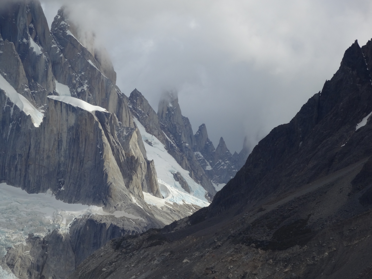 Approaching the jagged spires looming over Laguna Torre with Cerro Torre under cloud